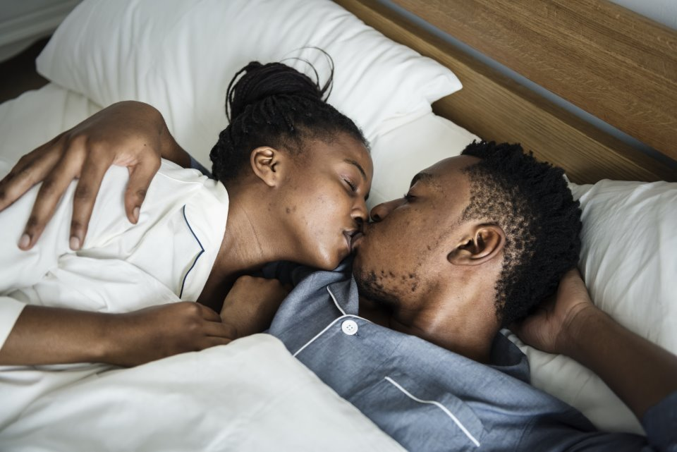 A black man and woman having natural insemination